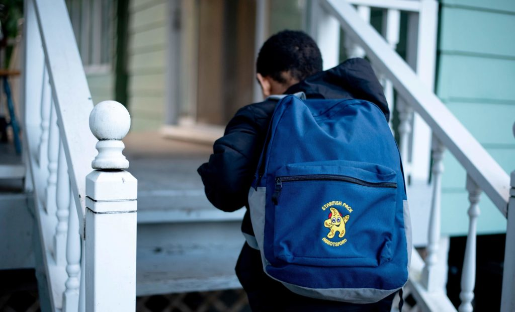 young boy with a starfish pack backpack
